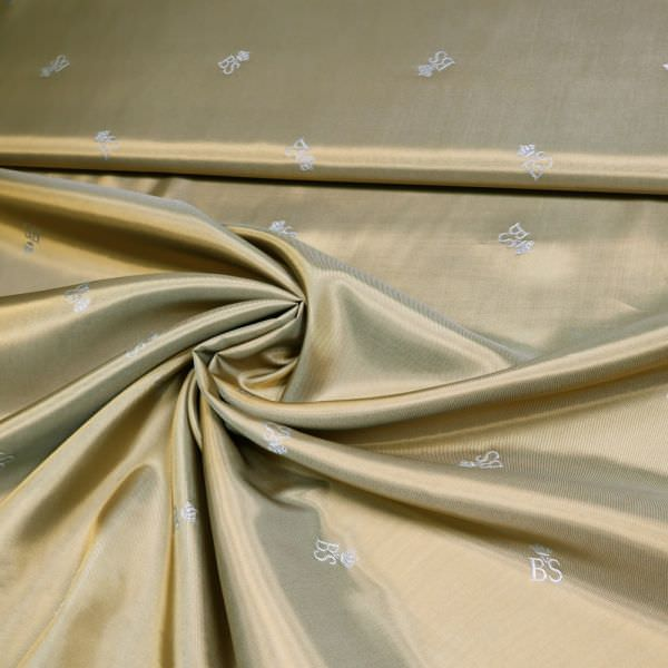 Designer Futterstoff Viskose- Jacquard Logo-Muster & Changierend - ocker/silbergrau