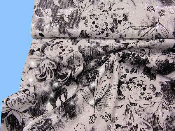 Baumwollstoff mit eingenähten Pailletten - schwarz/wollweiss