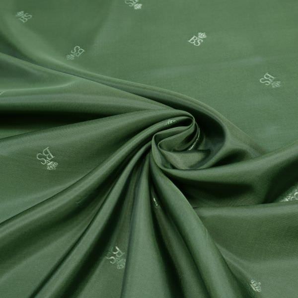 Designer Futterstoff Jacquard Logo-Muster & Changierend - grün/schwarz